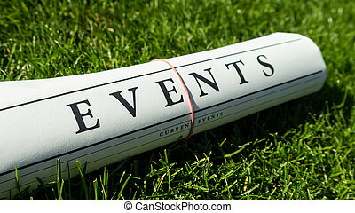 events newspaper on a green meadow