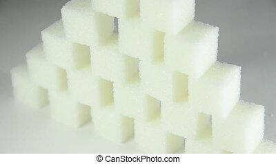 Pyramid of white sugar cubes (rotating)