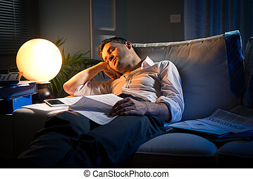 Overworked businessman on sofa - Tired businessman sleeping...