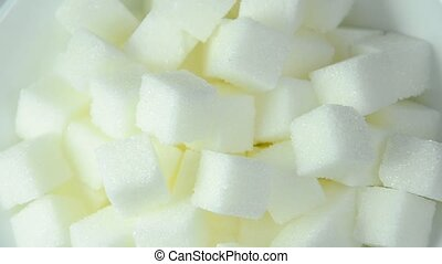 close up of sugar cubes on white background