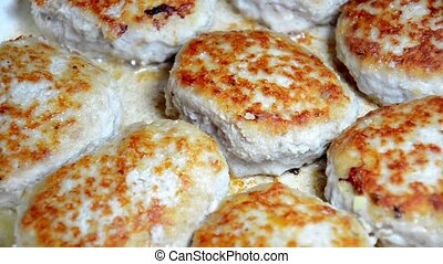 Fried cutlets on a frying pan