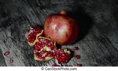 Pomegranate slices and seeds old wooden table