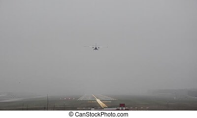 The plane lands in fog, in bad weather