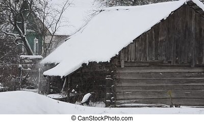 Heavy snowfall, an abandoned house