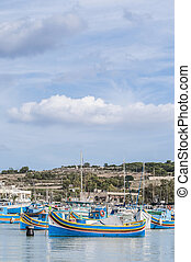 Traditional Luzzu boat at Marsaxlokk harbor in Malta -...