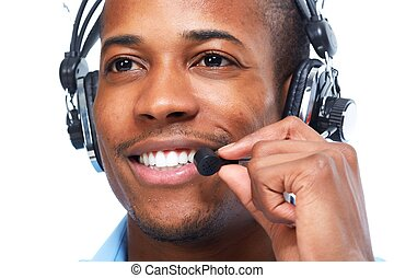 African American man in headsets. - African American man in...