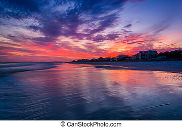 Waves in the Atlantic Ocean at sunset, in Folly Beach, South...