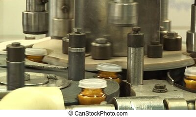 Packaging of tablets in a glass con - Automated production...