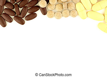 Multi colored pills scattered on white background with...