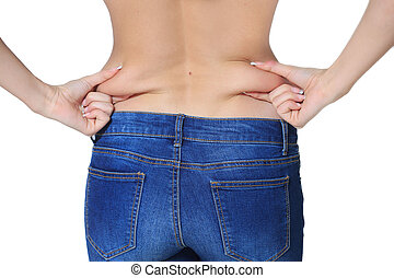 Fat woman isolated over white - belly fat. jeans. girl pulls...