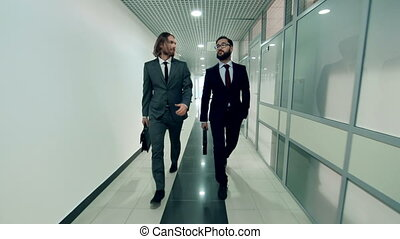 Business Becomes Them - Two handsome businessmen going along...