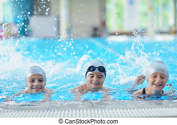children group at swimming pool - group of happy kids...