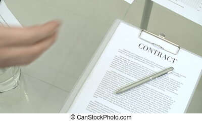 Coming to Agreement - Close up of contract and other...