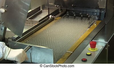 Automated production of medicines. Placing on the conveyor...