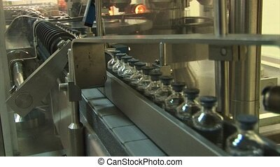 Filling drug vials. - Automated production of medicines....