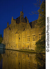 Dijver Canal in Bruges at night - Historic houses along...