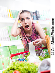 Expensive grocery store - Young woman shouting and checking...
