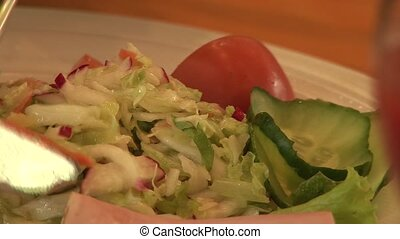 Man dines in a restaurant salad vegetables and meat