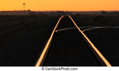 Train tracks sunset. Heat shimmer. - Train tracks going off...