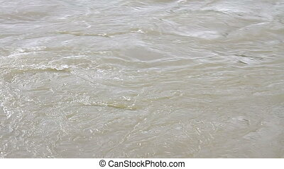 flooding river after a storm - close up of flooding river...
