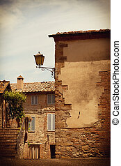Wall of the old house and ladder in the ancient Italian...