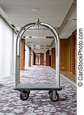 hotel luxury trolley barrow silver chrome parked at walkway...