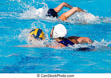 Water Polo Game - Water polo action and equipment in a...
