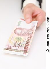 thai baht bill - Hand With thai baht bill