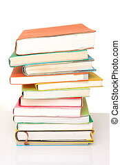 stacked books - studio shot of stacked books on white...