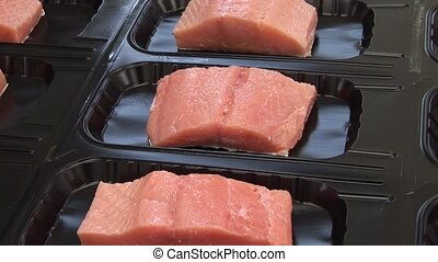 Vacuum packing red fish trout, salmon, pink salmon Seafood...
