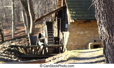 Ancient Mill - Changing focus to an old mill building with...