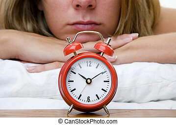 Woman Asleep - Woman with red alarm clock representing...