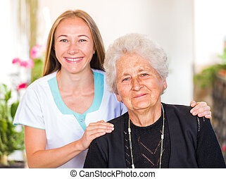 Elderly home care - Photo of happy elderly woman with her...