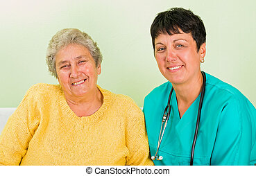 Home care - Photo of elderly woman with the doctor