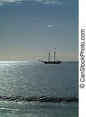 Sailing ship off the coast