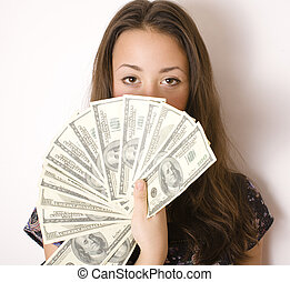 portrait of pretty young woman with money, isolated on white...