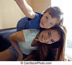 mother with son, happy family at home interior