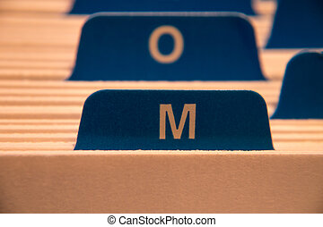 filing system with letter m