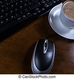 keyboard, cup coffee and mouse on desk