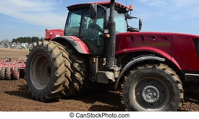 Tractor sowing wheat - Sowing campaign. Tractor sowing...