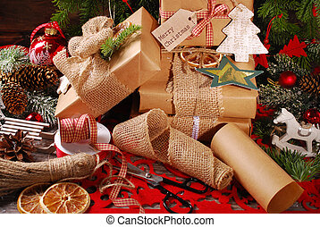 wrapping christmas presents in eco paper with homemade...