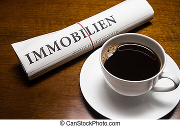 immobilien newspaper german and cup of coffee