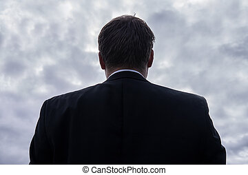 adult businessman and cloudy sky - adult businessman looking...