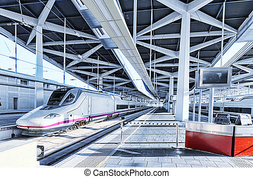 Modern high speed train at the railways stantion. - Modern...
