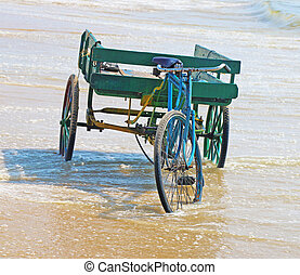 cart and bike on the beach chennai india - ancient cart and...