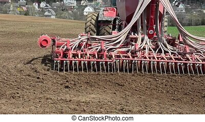 Tractor sowing wheat