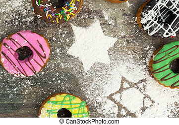 bright donuts on wooden background,