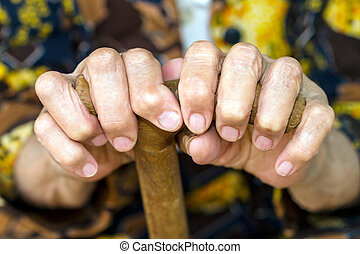 Hands on walking canes - Hands of an old woman on walking...