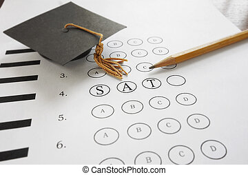 SAT exam - SAT test with pencil and mortar board graduation...