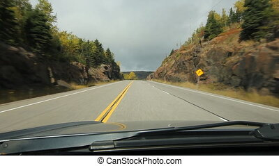 Autumn hill. Rock cut and corner. - Driving through a rock...